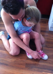 Daddy helping with her new Yo Gabba Gabba shoes.  He is a great daddy.